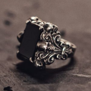 Six Skull Black Agate Ring